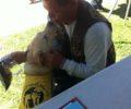 Rider Receiving A Puppy Kiss